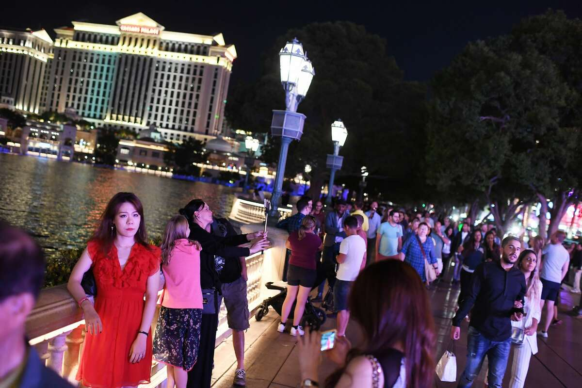 People are seen near the Fountains of Bellagio on Wednesday October 04, 2017 in Las Vegas, NV.