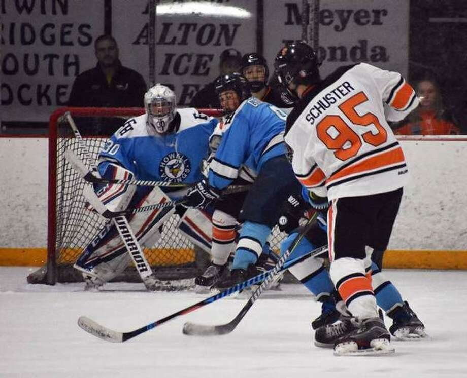 Edwardsville's William Schuster fires a shot through traffic from just inside the blue line in the second period during a regular season game against Francis Howell. Photo: Matt Kamp/Intelligencer