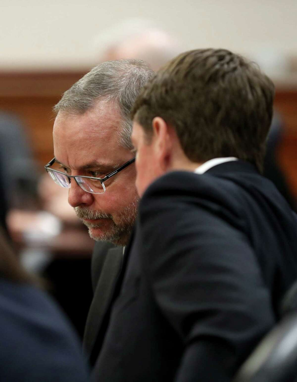 Galveston County Criminal District Attorney Jack Roady talks with First Assistant District Attorney Kevin Petroff at the Galveston County Courthouse on Monday, Jan. 28, 2019, before a status conference for Dimitrios Pagourtzis, the student accused of killing 10 people in a May 18 shooting at Santa Fe High School. Pagourtzis' attorneys have filed a motion for a change of venue.