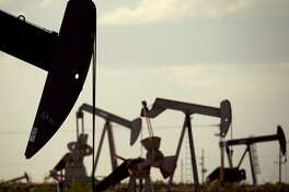 FILE - In this April 24, 2015 file photo, pumpjacks work in a field near Lovington, N.M. The boom in US oil production is expected to satisfy most of the world's growing appetite for oil through 2023, according to a new forecast by a global energy group. The International Energy Agency worries that that investment in oil exploration and production is too low. The result could be the thinnest margin of oil-production capacity over demand in more than a decade. (AP Photo/Charlie Riedel, File)