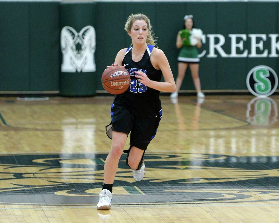 Taylor Woods (23) of Taylor dribbles past mid-court during the second half of a high school basketball game between the Mayde Creek Rams and the Taylor Mustangs on Friday, Jan. 25, 2019 at Mayde Creek High School. Photo: Craig Moseley, Houston Chronicle / Staff Photographer / ©2019 Houston Chronicle