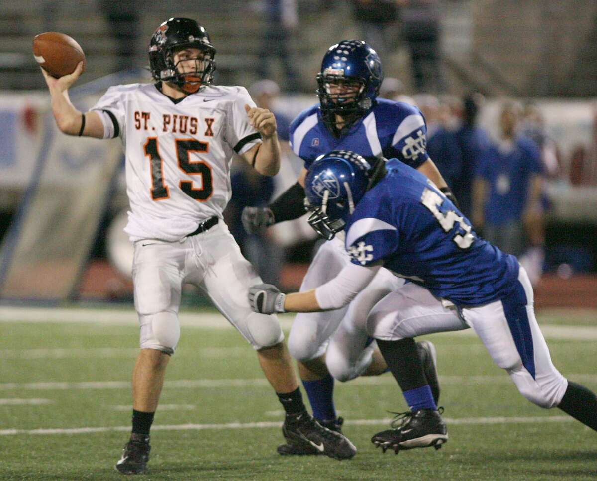 St. Pius quarterback Billy Noonan (15) is pressured by Nolan Catholic Beau Coleman (51) and Michael Cecero (90) during first quarter at the TAPPS 6A state championship footoball game Sat. Dec. 1 in Temple, Texas.
