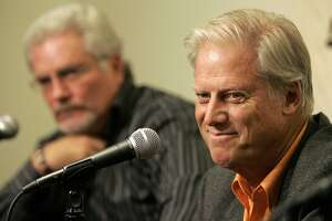 File-This Sept. 21, 2007, file photo shows San Francisco Giants' owner Peter Magowan, right, and general manager Brain Sabean speaking at a news conference in San Francisco, Friday, Sept. 21, 2007. The longtime San Francisco Giants owner has died at the age of 76. The team said Magowan died Sunday, Jan. 27, 2019, after a battle with cancer.  (AP Photo/Jeff Chiu, File)