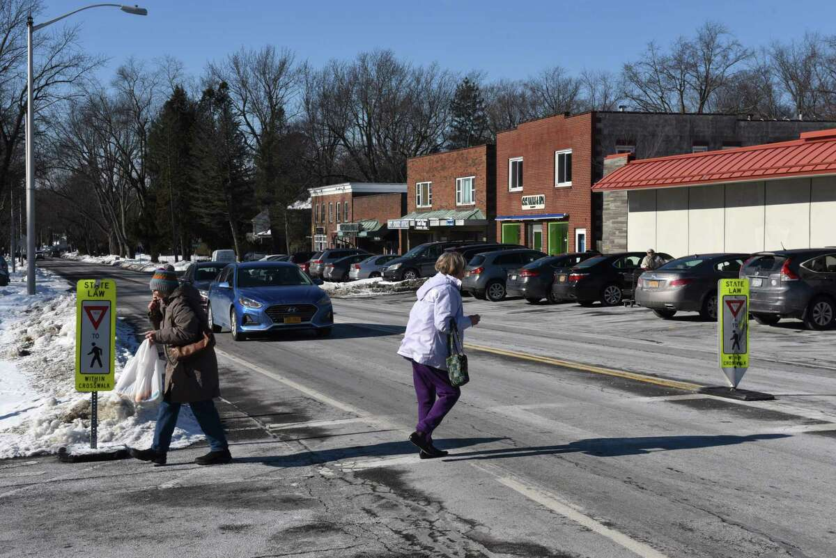 Shoppers cross Nott Street near the Niskayuna Co-op supermarket on Monday, Jan. 28, 2019, in Niskayuna, N.Y. Schenectady County, with support from the Town of Niskayuna, has secured a $1.5 million federal grant to improve Nott Street in the area between Balltown Road and Clifton Park road. The goal is to reduce accidents, improve safety pedestrian safety and support accessibility for local businesses. (Will Waldron/Times Union)