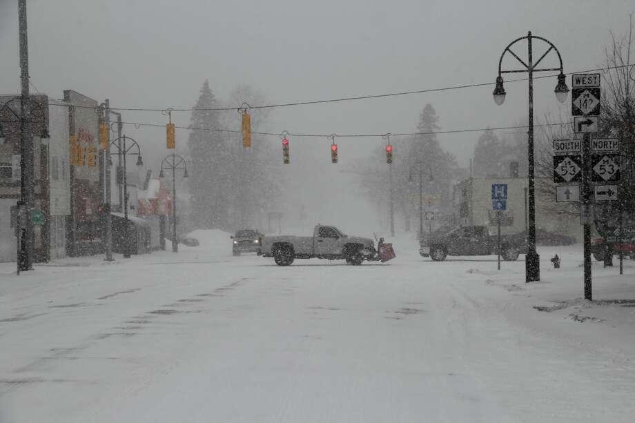 Some scenes from Monday's snowstorm. Photo: Seth Stapleton/Huron Daily Tribune