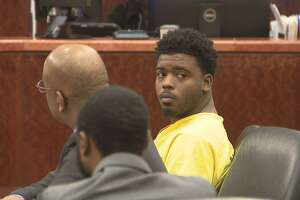 Eric Black Jr., right, appears in court with his attorney Alvin Nunnery, left, on Monday.