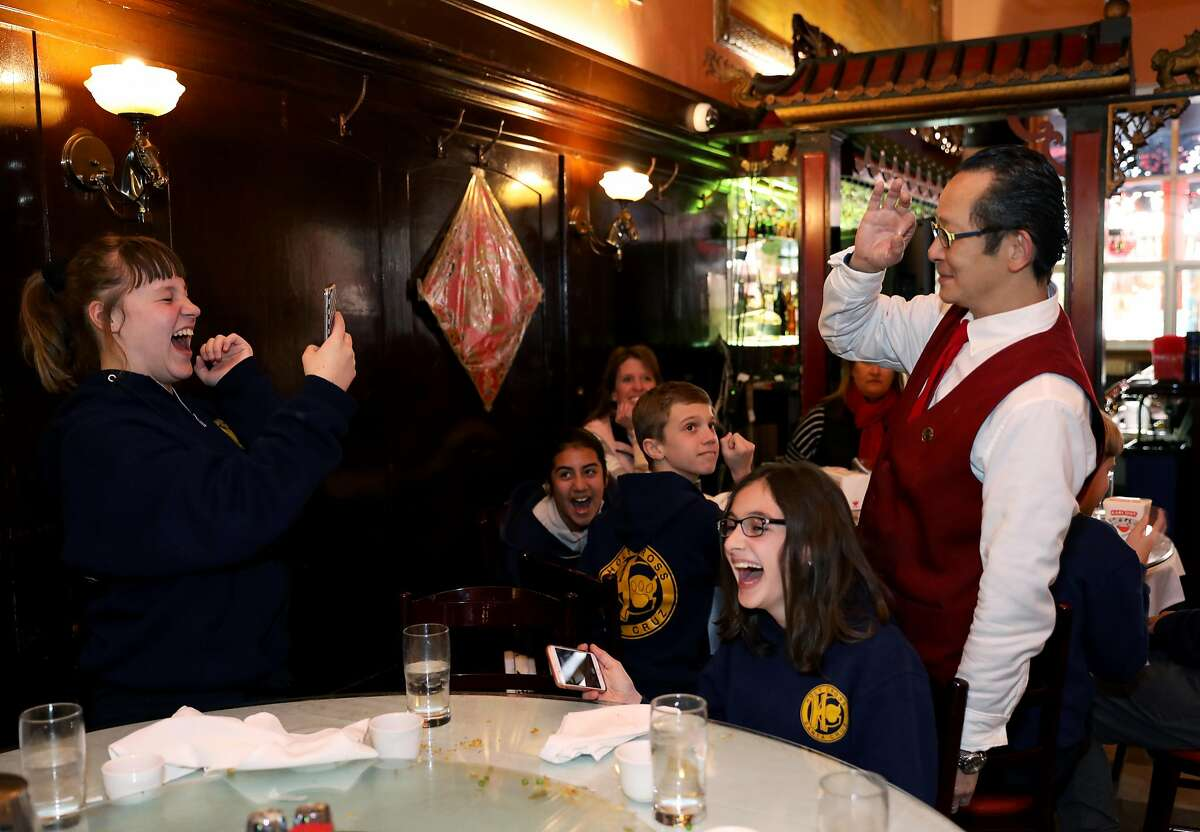 Arianna Cart, 11, a sixth grade student at Holy Cross School in Santa Cruz, shoots a photo of Alan, a busser who didn't want to provide his last name, at Far East Cafe in San Francisco, Calif., on Tuesday, January 22, 2019. The restaurant, which is about to celebrate its 100th anniversary, is located at 631 Grant Ave. It serves classic Chinese American and Cantonese food in an era when immigration is changing and restaurants are specializing in regional cuisines from all over China.