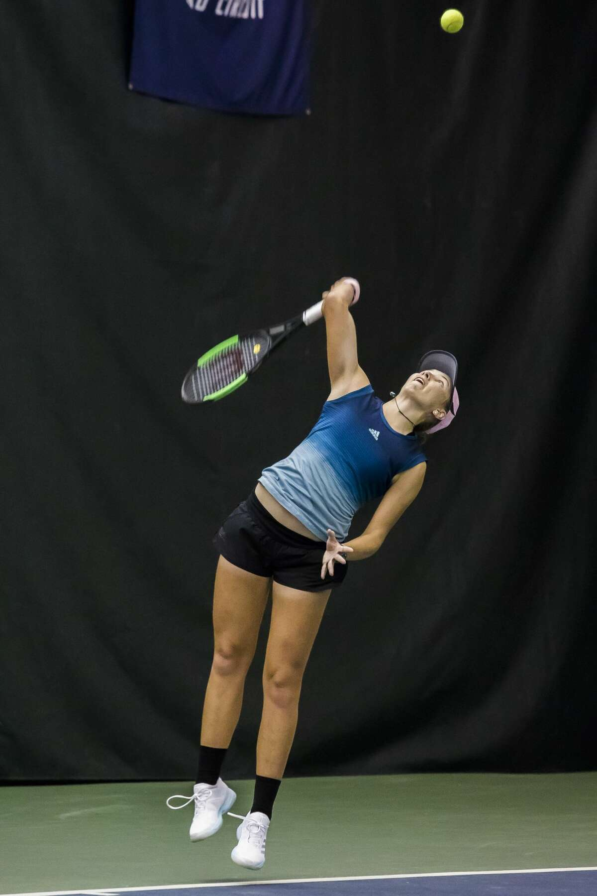 Ellie Coleman of Midland serves the ball during a match against Jovana Jaksic of Serbia during the qualifying tournament of the Dow Tennis Classic on Monday, Jan. 28, 2019 at the Greater Midland Tennis Center. (Katy Kildee/kkildee@mdn.net)