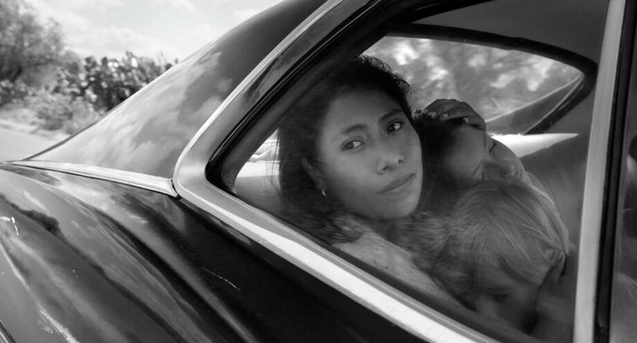 "Yalitza Aparicio as Cleo, Marco Graf as Pepe, and Daniela Demesa as Sofi in ""Roma,"" written and directed by Alfonso Cuarón. Photo: Carlos Somonte / TNS / Netflix"