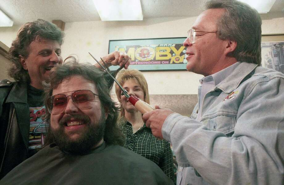 KLOL's Mark Stevens, left, and Jim Pruett prepare to give fellow disc jockey Moby (James Smith Carney) a haircut on Jan. 17, 1989, at Allen Park Inn. During the Star-a-Thon '89 for United Cerebral Palsy telethon, Moby said he would cut his hair like KHOU meteorologist Neil Frank for a $5,000 contribution. Soon thereafter, the money rolled in and Moby lived up to his promise. Photo: Ben DeSoto, Houston Chronicle
