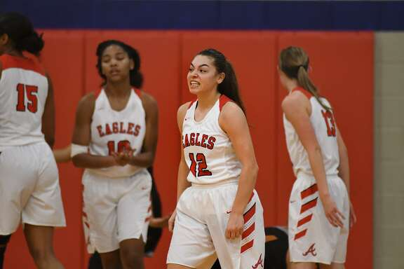 Atascocita Lady Eagles senior guard Brittney Stafford shows off her game face after making a play against Dobie during their District 22-6A matchup at Atascocita High School on Jan. 25, 2019.