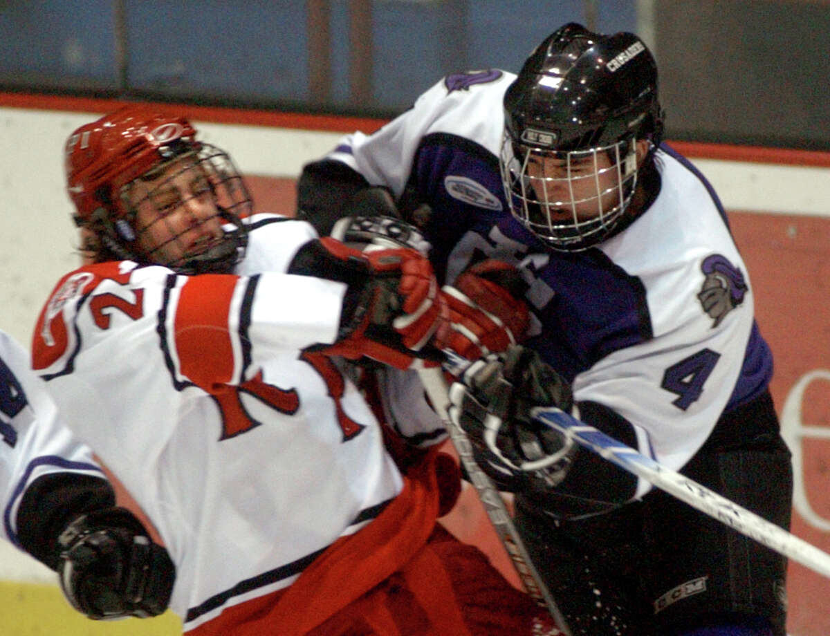 FILE -RPI's Tyler Eaves, left, tussles with Holy Cross' Shane McAdam, right, during their hockey game Friday, Nov. 25, 2005, at Rensselaer Polytechnic Institute in Troy, N.Y.