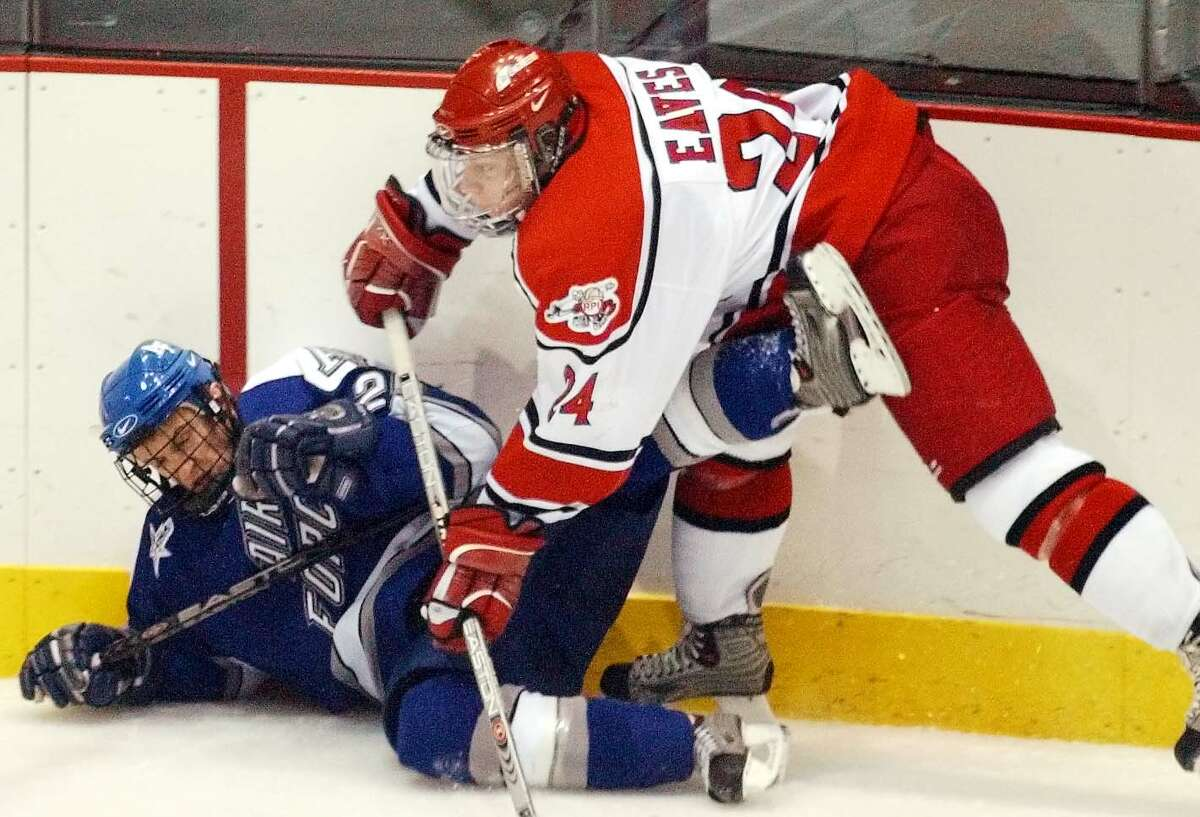FILE - RPI #24-Tyler Eaves hits Air Force #27-Matt Bader hard on the boards on Nov. 27, 2004. inthe second period of the RPI Tournament Championship game. In Houston Field House in Troy N.Y.