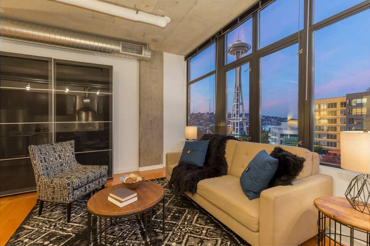 This chic sub-penthouse at Mosler Lofts comes with a mix of industrial and luxe, and fantastic Needle and Queen Anne views. Exposed concrete ceilings, hard surface flooring throughout, and an open floor plan all in a convenient Belltown location with a concierge and rooftop deck accessible too. 2720 Third Avenue, #1107, listed for $485,000. See the full listing here.