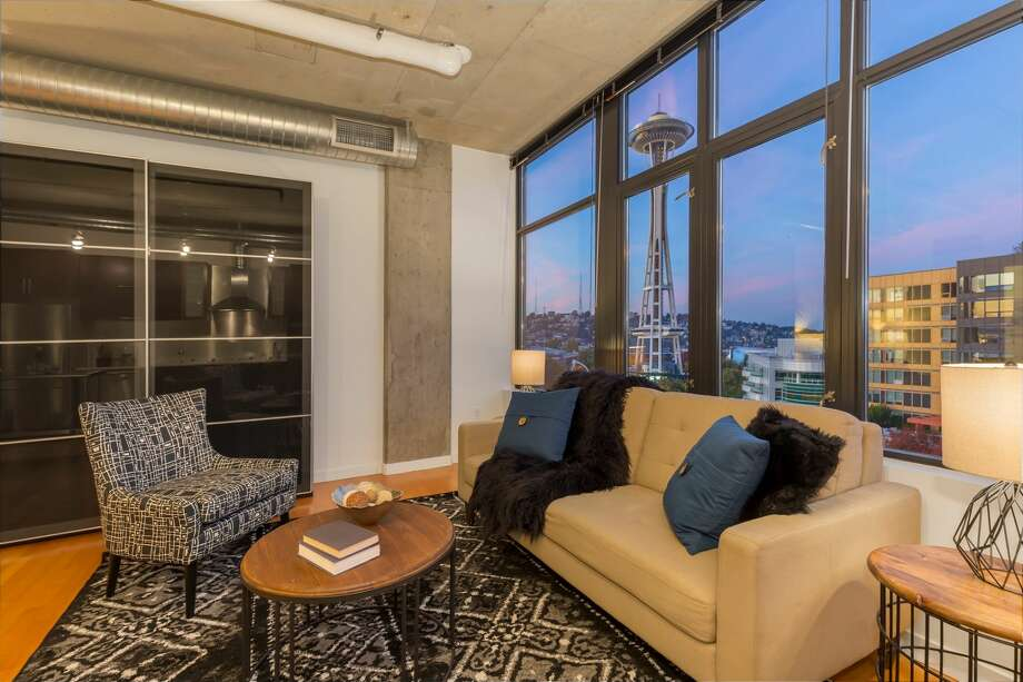 This chic sub-penthouse at Mosler Lofts comes with a mix of industrial and luxe, and fantastic Needle and Queen Anne views. Exposed concrete ceilings, hard surface flooring throughout, and an open floor plan all in a convenient Belltown location with a concierge and rooftop deck accessible too.
