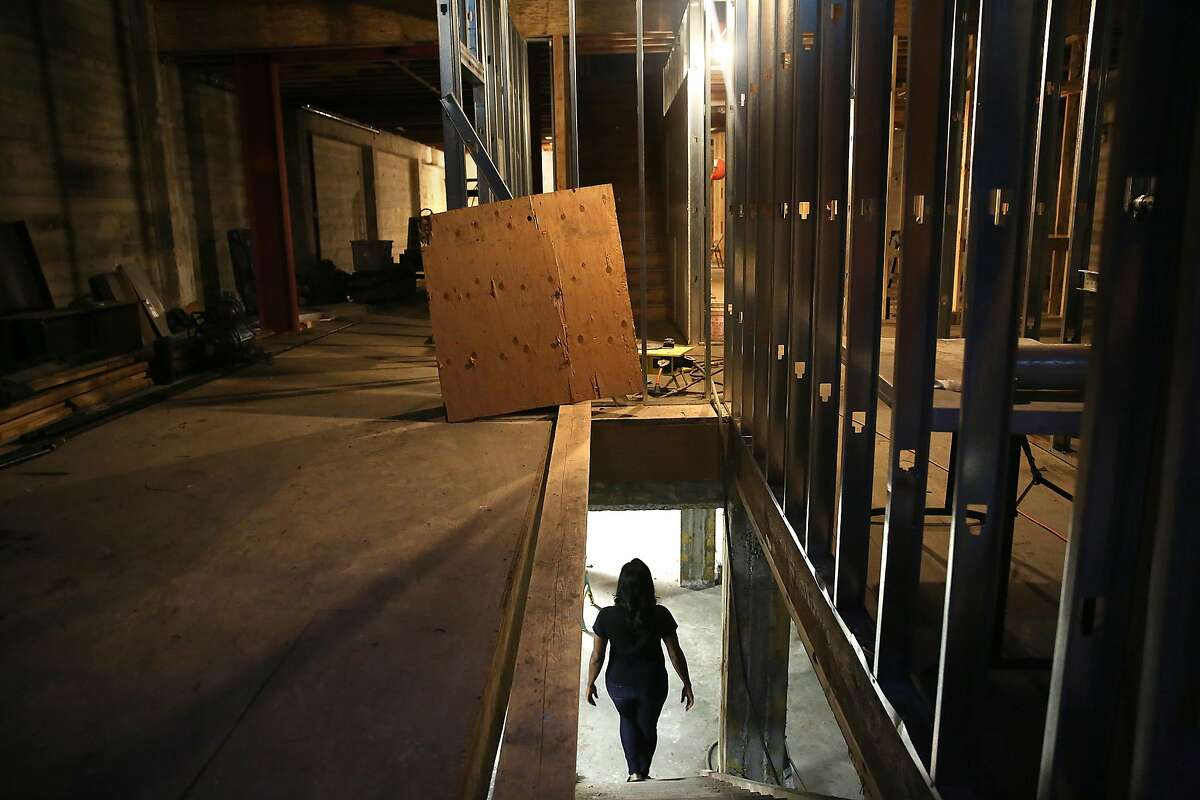 Michele Wilson, owner of now-closed Fillmore restaurant Gussie's House of Chicken and Waffles, shows her Oakland restaurant under construction next to the Paramount Theater Oakland, California, on Friday, November 27, 2015.