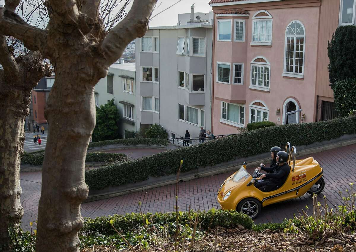 Cars drive down the famously crooked portion of Lombard Street in San Francisco, Calif. Saturday, Jan. 26, 2019.