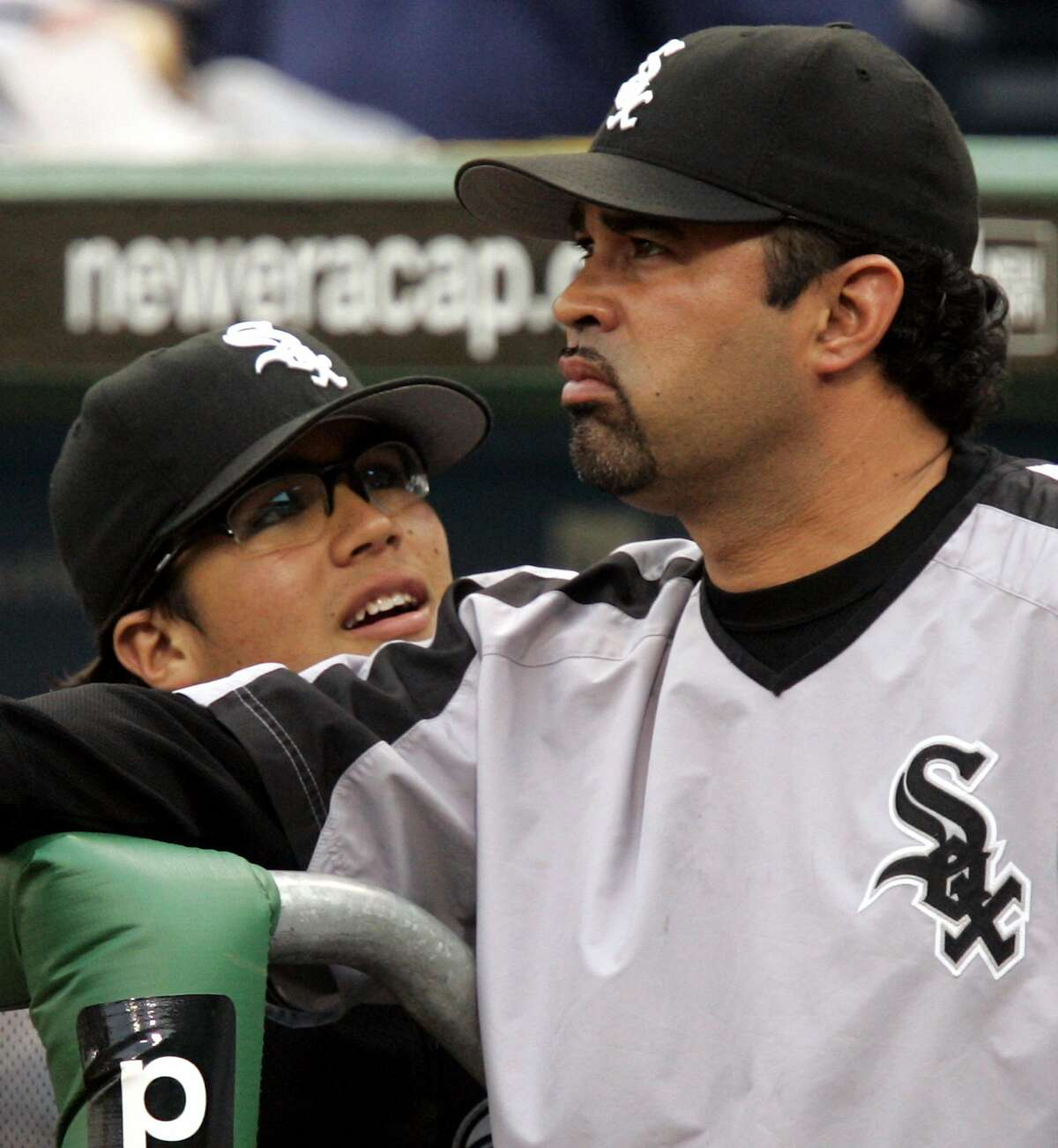 Chicago White Sox manager Ozzie Guillen's son, Ozney, 13, left, works with his dad as a batboy during a 4-3 win over the Pittsburgh Pirates in baseball action Wednesday, June 28, 2006, in Pittsburgh.(AP Photo/Gene J. Puskar)