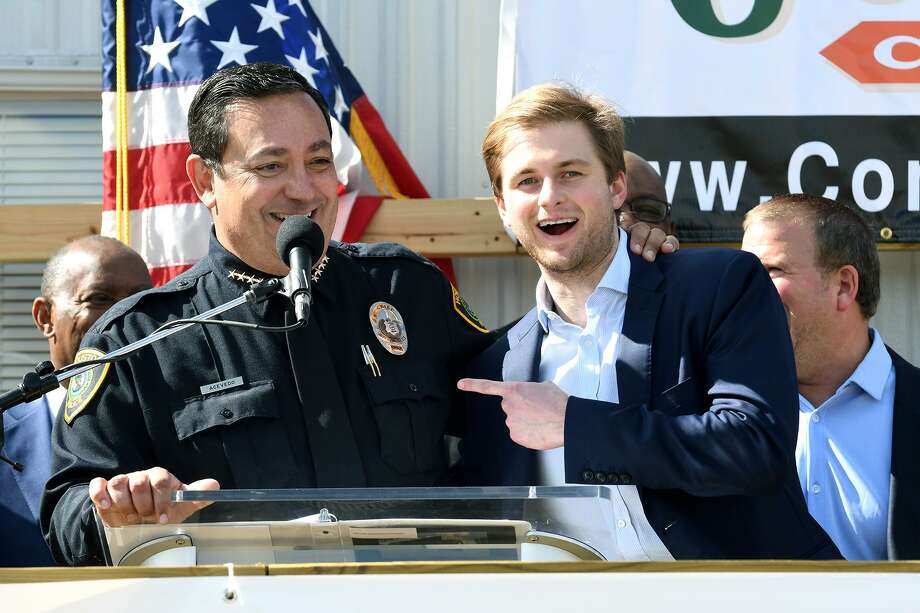 Houston Chief of Police Art Acevedo, from left, shares a laugh at the podium with Patrick Fertitta, a son of Tilman Fertitta, Chairman of the Board for the Houston Police Foundation, during the groundbreaking ceremony for the Tilman Fertitta Family Tactical Training Center in Houston on Jan. 28, 2019. Photo: Jerry Baker, Houston Chronicle / Contributor / Houston Chronicle
