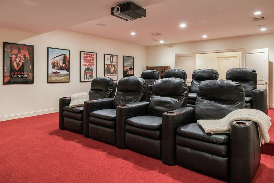 The home theater is just one of the many amenities at 7 Wyckham Hill Lane, a mid-country estate with a nearly 14,000 square foot Georgian colonial, lakefront dock, pool and spa, and tennis court. Coldwell Banker Residential Brokerage has the property listed for $6.95 million. Photo: Coldwell Banker Residential Brokerage / © 2017 Daniel Milstein Photography