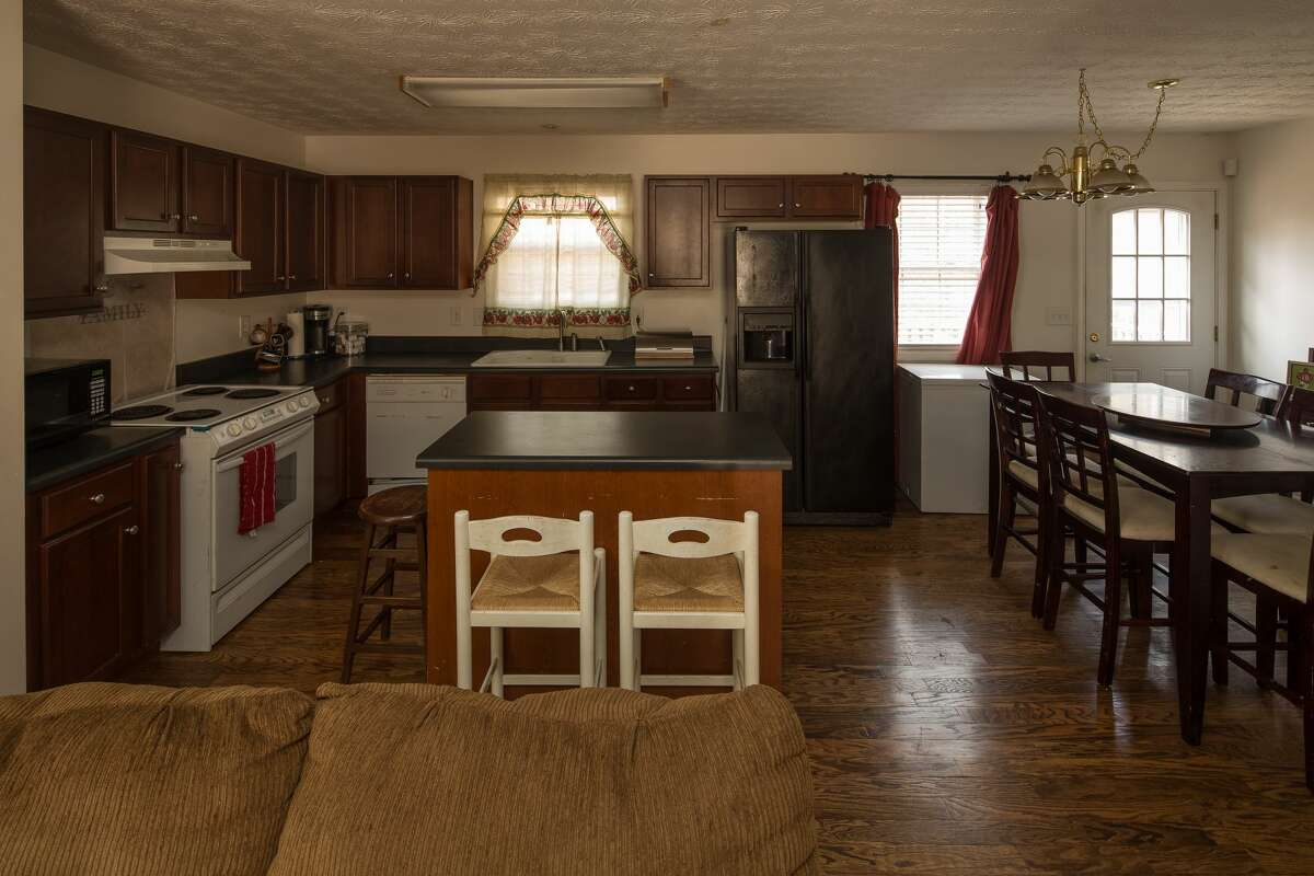 Before: The Watson family moved into this Habitat for Humanity home when Deshaun was 11 and little had changed in the home since then. It had limited natural light, and the dark cabinets, wood floors and lack of lighting made it feel dark and dated.