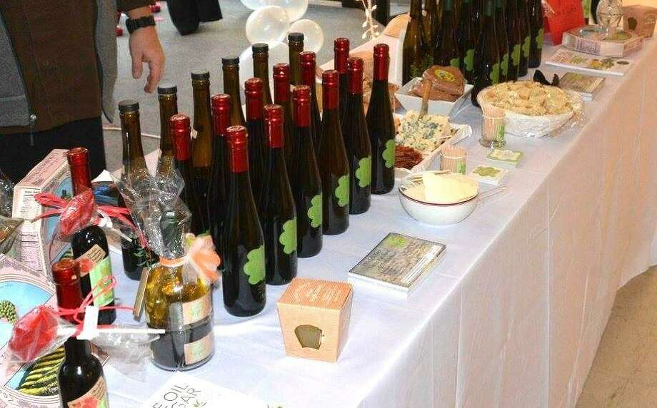 Winsted's Friends of Main Street are holding the annual Bubbles & Truffles fundraiser at Crystal Peak in Winsted on Friday, Feb. 8. Above, a table at last year's event offers guests plenty of wine to taste. Photo: Contributed Photos /