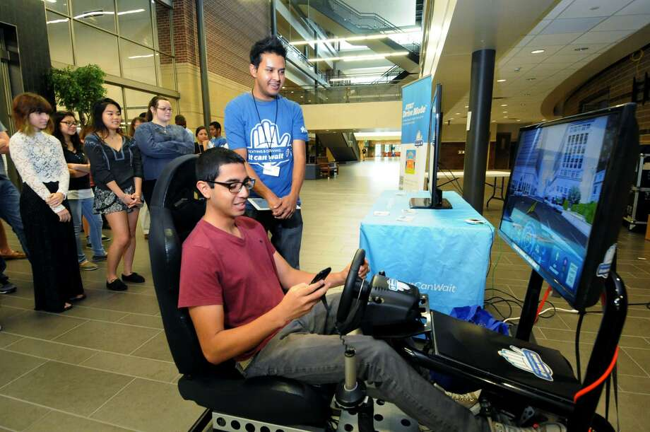 A student in Klein near Houston tries an AT&T simulator that demonstrates the dangers of texting while driving. A reader pleads with drivers to quit the practice. Photo: Staff File Photo / Internal