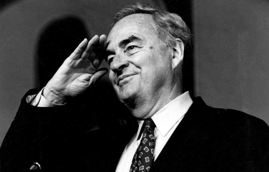 In 1994, Sen. Harris Wofford, D-Pa., salutes during the opening session of the Pennsylvania AFL-CIO convention. He helped found the Peace Corps, VISTA, AmeriCorps and Senior Corps. All the corps encouraged service to the country, the cause he advocated with evangelical zeal. Photo: Associated Press File Photo / Pittsburgh Post-Gazette