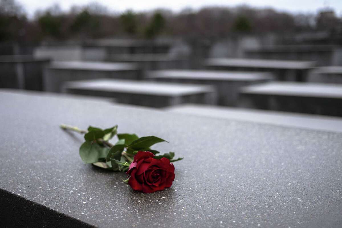 A red rose lies on a slab of the Holocaust Memorial to commemorate the victims of the Nazis in Berlin, Sunday, Jan. 27, 2019. The International Holocaust Remembrance Day marks the liberation of the Auschwitz Nazi death camp on Jan. 27, 1945.