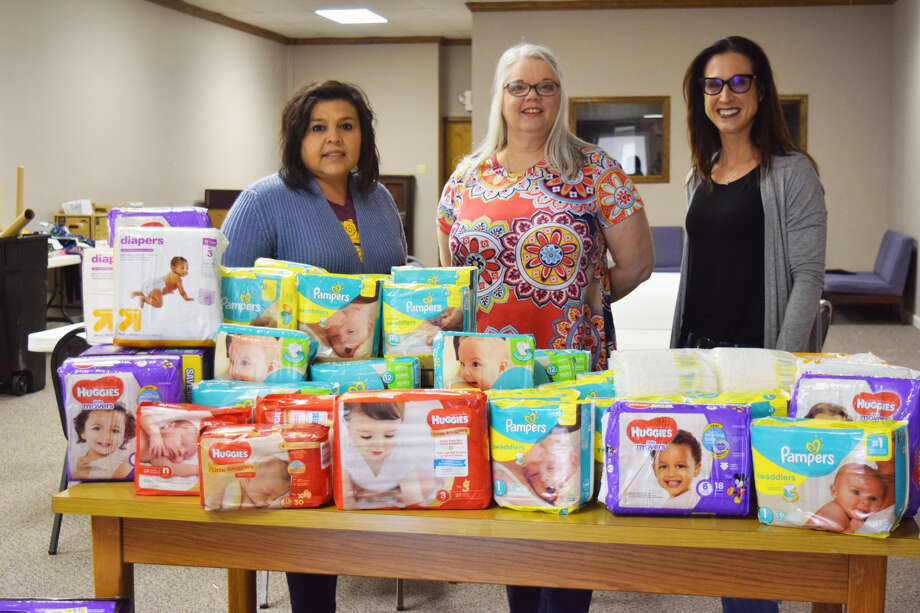 Presenting Hale County's Rainbow Room with more than 1,500 diapers was Covenant Health Plainview nurses Rosie Aldape, RN, (right) and Tamara McCasland, RN, (middle). The two nurses recently held a diaper drive for the organization. Accepting the donation on behalf of the Rainbow Room was Gretchen Massingill. Photo: Covenant Health Plainview