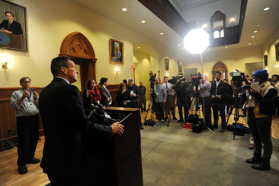 Then-Gov. Dannel P. Malloy addresses the media at New Haven City Hall in 2015 after meeting with a Syrian refugee family relocated to the city after being denied entry to Indiana. Photo: Brian A. Pounds / Hearst Connecticut Media / Connecticut Post
