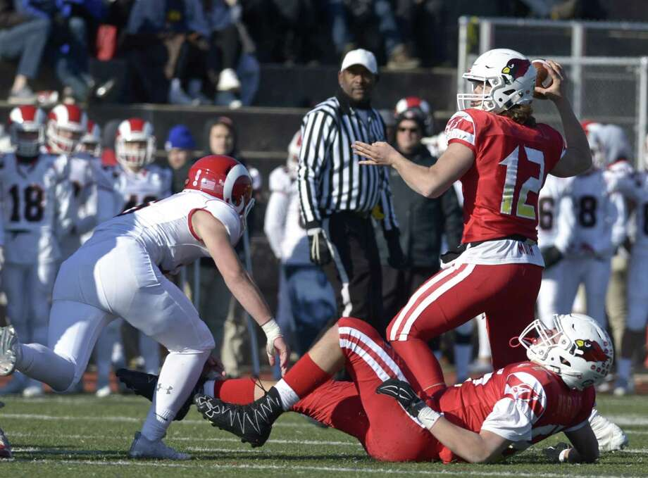Greenwich quarterback Gavin Muir (12) has committed to Dartmouth, where he will continue his football career. Photo: H John Voorhees III / Hearst Connecticut Media / The News-Times