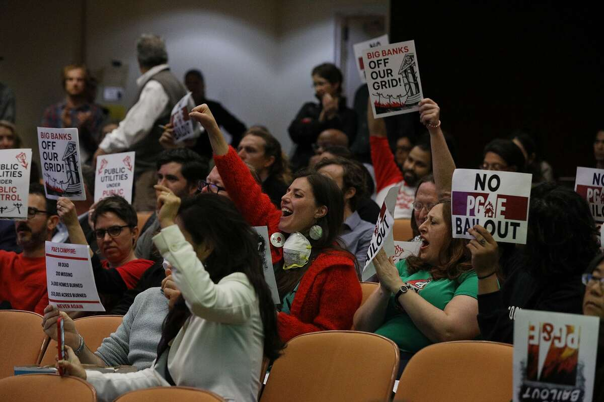 PG& protesters during a California Public Utilities Commission meeting in January. Author Joe Mathews argues that one of the reasons the CPUC has so much regulatory power in California is because it's willing to be Sacramento's punching bag.