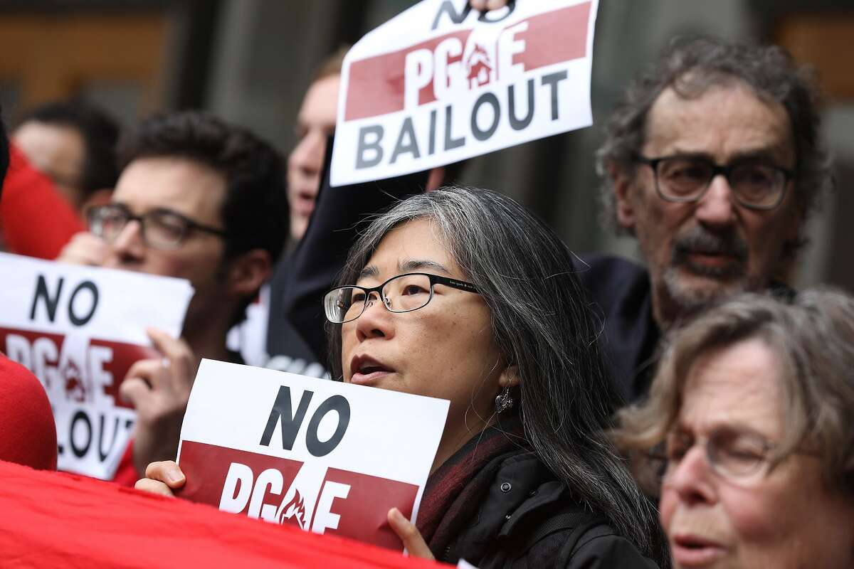 Melanie Liu with the California Progressive Alliance protests a PG&E bail out with others before a previously unscheduled California Public Utilities Commission meeting��on Monday, January 28, 2019.
