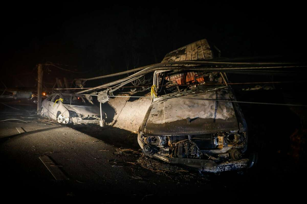 A vehicle is incinerated on Pearson Road after the Camp Fire ravaged the town of Paradise, California, on Friday, Nov. 9, 2018.