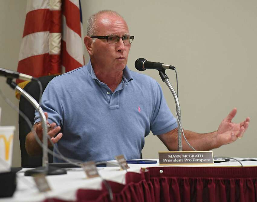 President ProTempore Mark McGrath speaks to Troy Police Chief John Tedesco as the city council meets with Tedesco about the spate of shootings and fires that have plagued the city in recent weeks on Monday, July 24, 2017 at Troy City Court in Troy, N.Y. (Lori Van Buren / Times Union)
