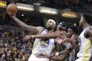 Golden State Warriors center DeMarcus Cousins (0) is fouled by Indiana Pacers center Myles Turner (33) during the first half of an NBA basketball game in Indianapolis, Monday, Jan. 28, 2019. (AP Photo/Michael Conroy)