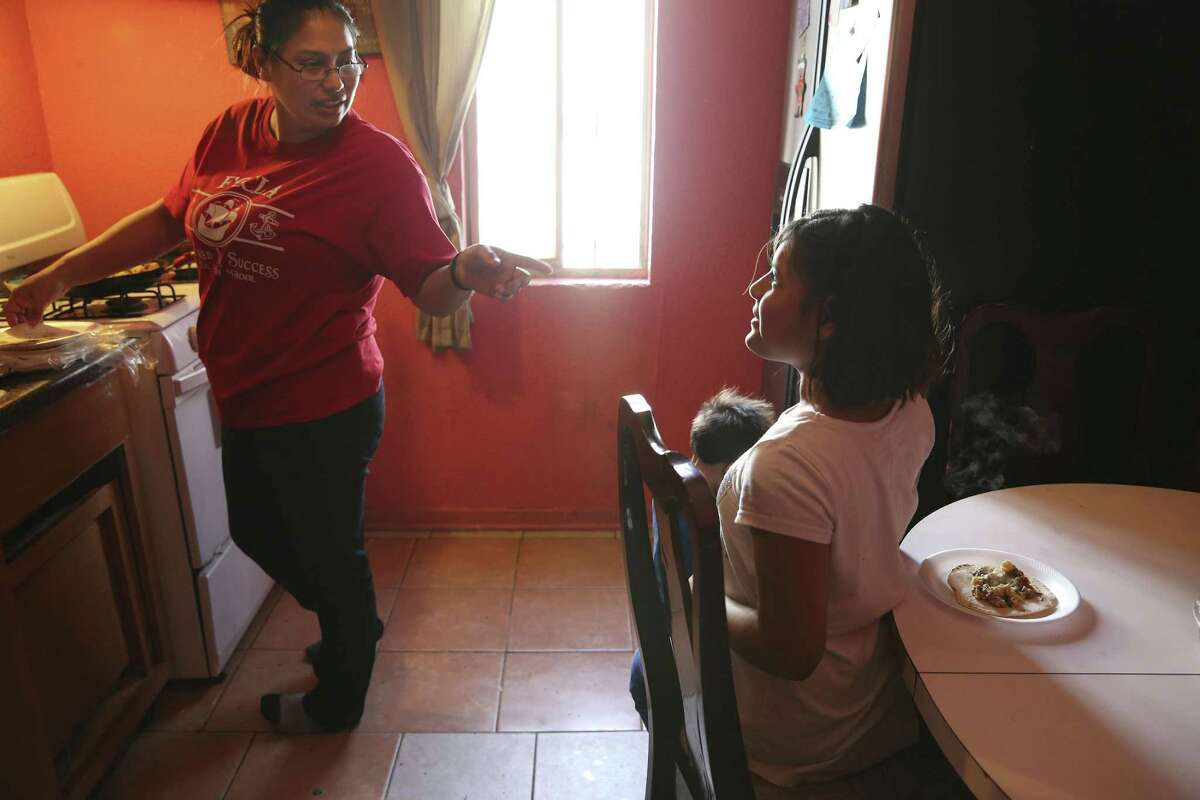 Crystal Guevara-Alvarado, 30, makes breakfast for her four children and two nieces, including her daughter, Ellena Guevara, recently. Guevara-Alvarado was an immigration detention officer at a private center in Pearsall, Texas, for seven years and was able to help support her family by working long hours at the job. Her divorce in 2015 led to instability and pressure on her family. She quit her job in November due to the long hours and commutes taking a toll on her four children. She moved in with her sister, who offered to help.