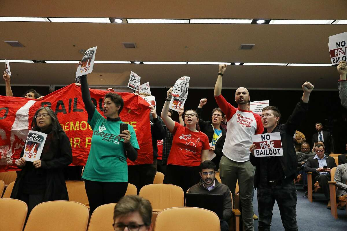 Demonstrators protest against a PG&E bailout during a previously unscheduled CPUC meeting on Monday, January 28, 2019 in San Francisco, Calif.