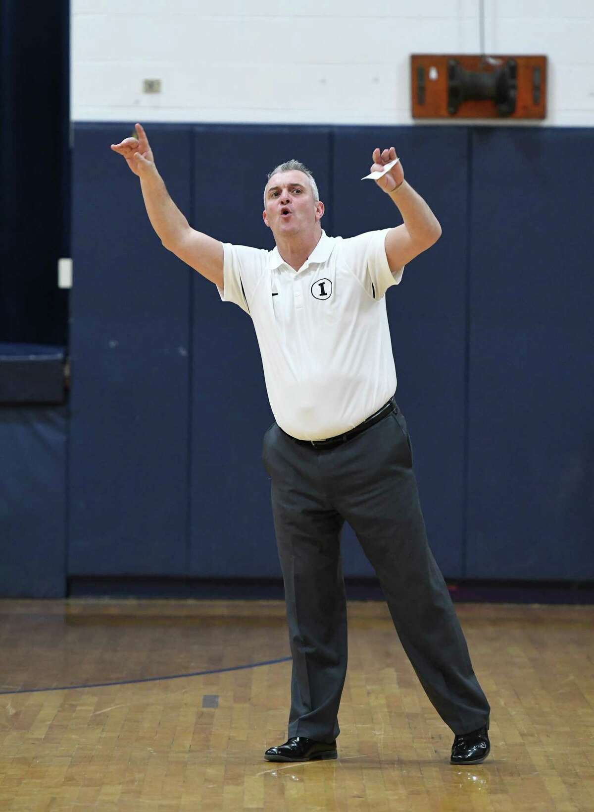 Immaculate coach Nelson Mingachos during the SWC boys basketball game between Newtown and Immaculate in Danbury, Jan. 28, 2019.