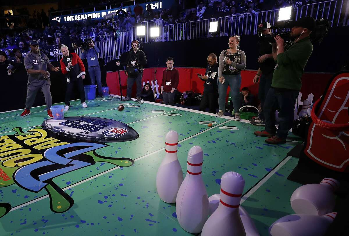 New England Patriots' Duron Harmon plays a game during Opening Night for the NFL Super Bowl 53 football game Monday, Jan. 28, 2019, in Atlanta. (AP Photo/David J. Phillip)