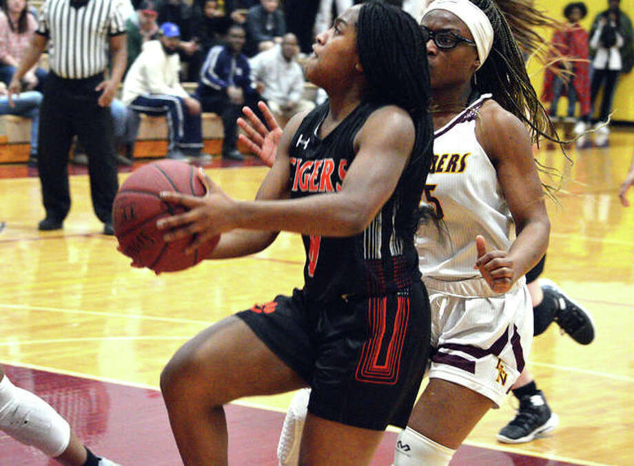 Edwardsville junior Quierra Love, left, drives to the basket during the third quarter of Monday's game at Lutheran North. Photo: Scott Marion/Intelligencer