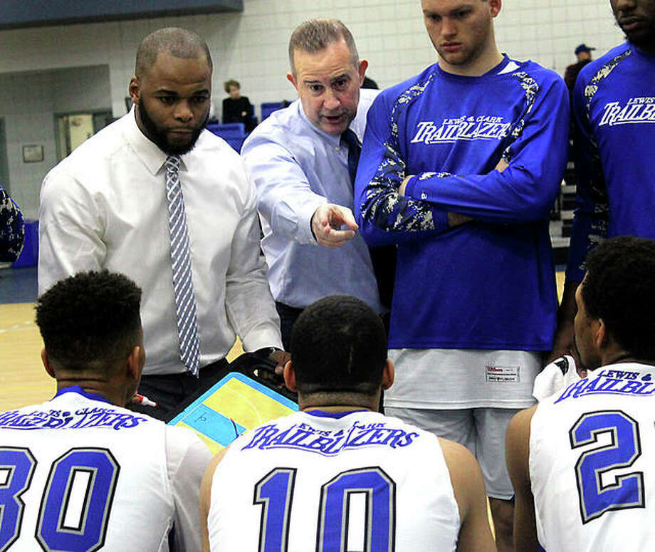 Lewis and Clark coach Doug Stotler, center, makes a point to his players during a timeout of Monday night's District 16 game against No. 4-ranked Vincennes University at the River Bend Arena. At left is assistant coach Kavon Lacey. Photo: Pete Hayes | The Telegraph