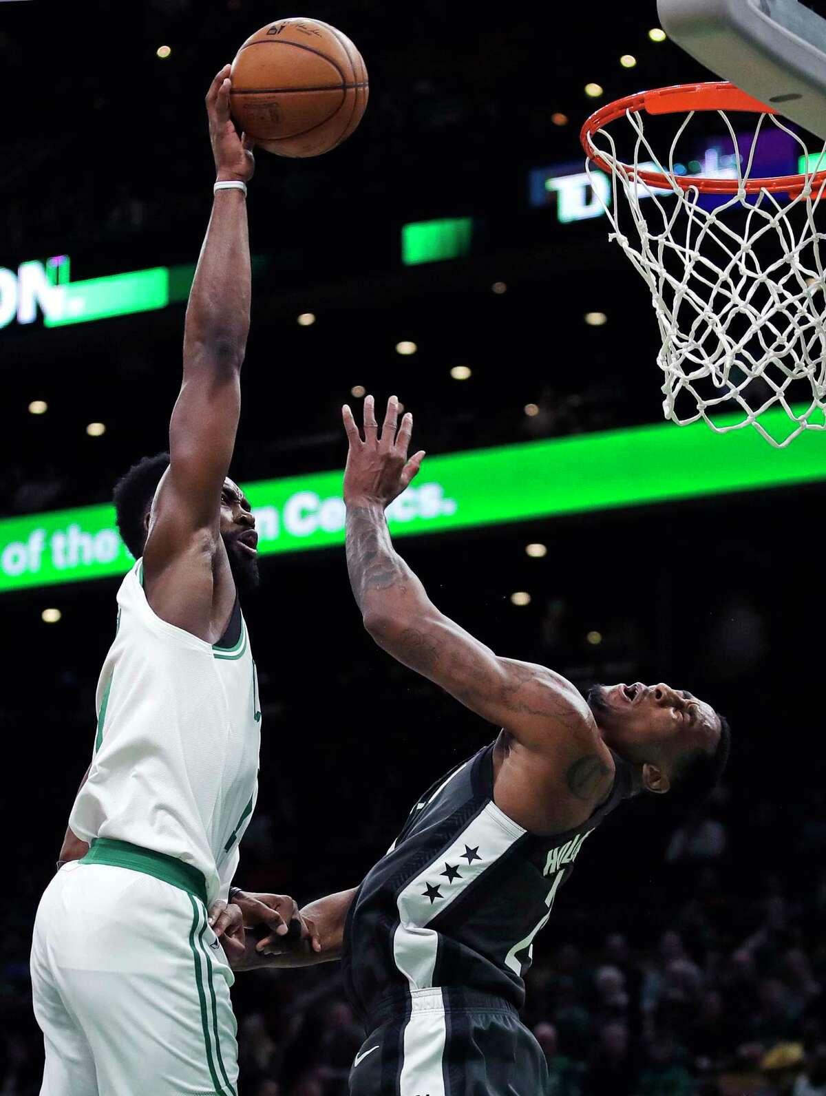 Boston Celtics guard Jaylen Brown, left, lines up a dunk over Brooklyn Nets forward Rondae Hollis-Jefferson, right, during the second half of an NBA basketball game in Boston, Monday, Jan. 28, 2019. The Celtics won 112-104. (AP Photo/Charles Krupa)