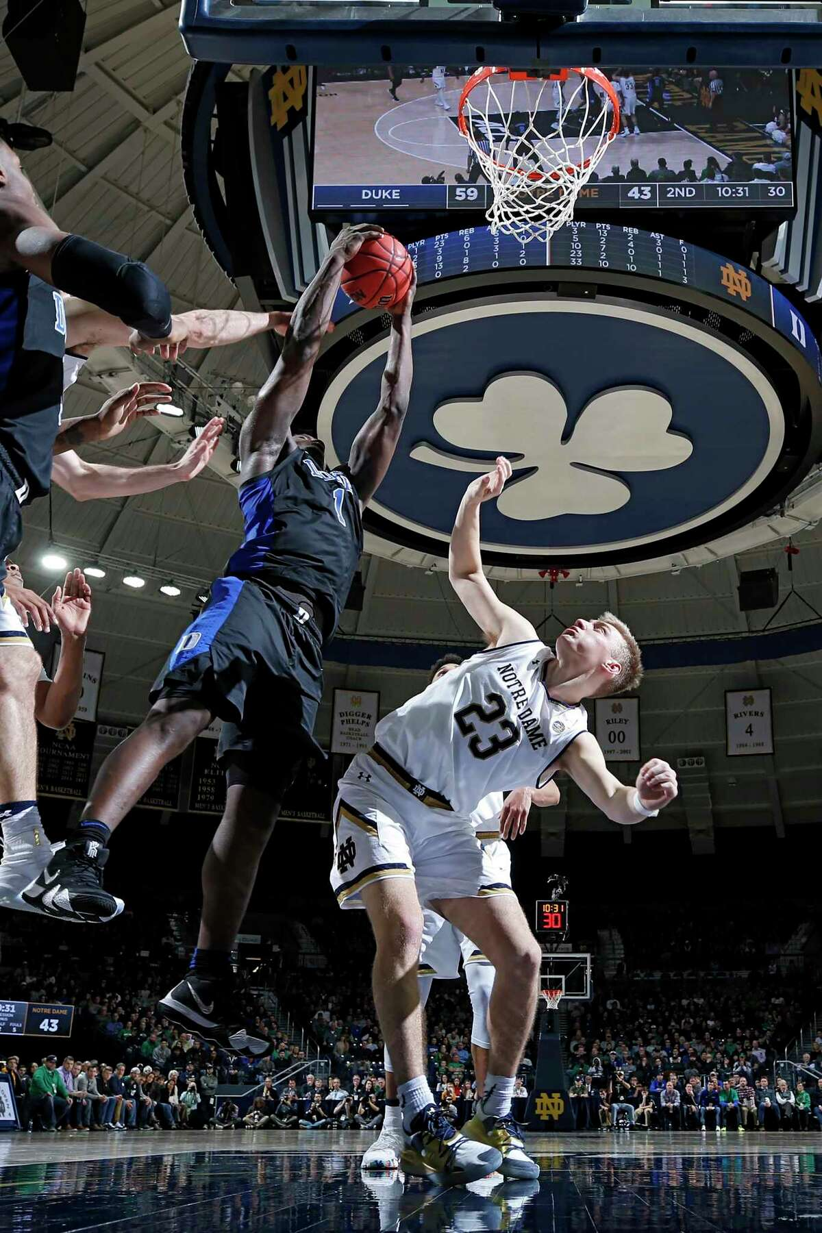SOUTH BEND, IN - JANUARY 28: Zion Williamson #1 of the Duke Blue Devils rebounds over Dane Goodwin #23 of the Notre Dame Fighting Irish in the second half of the game at Purcell Pavilion on January 28, 2019 in South Bend, Indiana. Duke won 83-61. (Photo by Joe Robbins/Getty Images)
