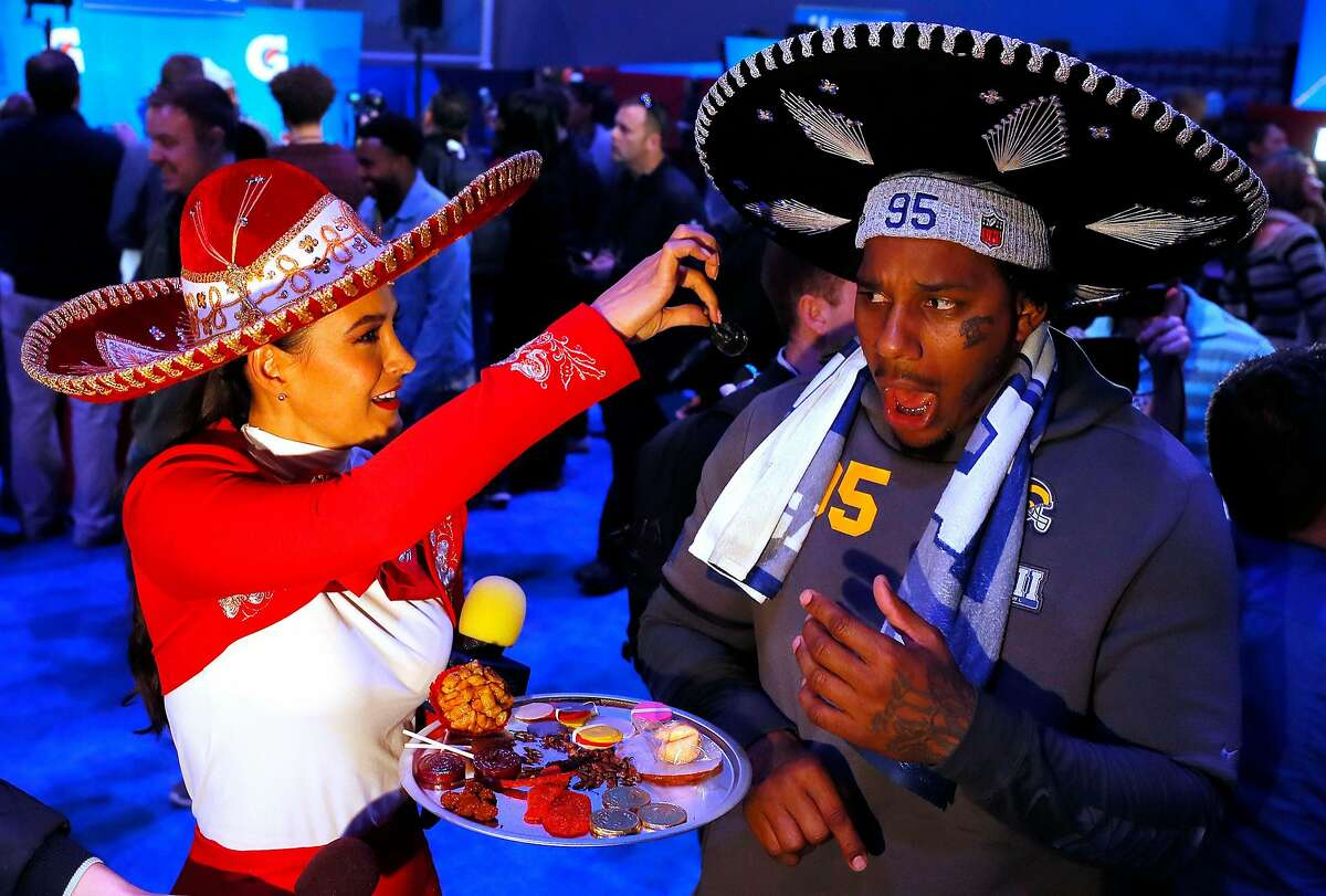 ATLANTA, GEORGIA - JANUARY 28: Ethan Westbrooks #95 of the Los Angeles Rams reacts as he is offered a scorpion from a reporter from Televisa during Super Bowl LIII Opening Night at State Farm Arena on January 28, 2019 in Atlanta, Georgia. (Photo by Kevin C. Cox/Getty Images)