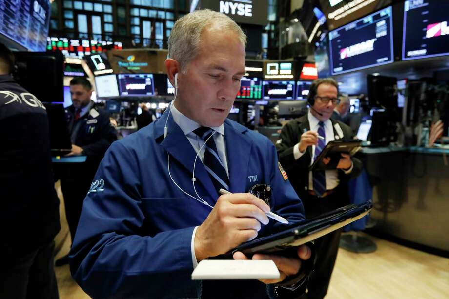 Trader Timothy Nick, center, works on the floor of the New York Stock Exchange, Monday, Jan. 28, 2019. Stocks are opening broadly lower on Wall Street as traders worry about the impact on U.S. companies of a slowdown in China's economy. (AP Photo/Richard Drew) Photo: Richard Drew / Copyright 2018 The Associated Press. All rights reserved.