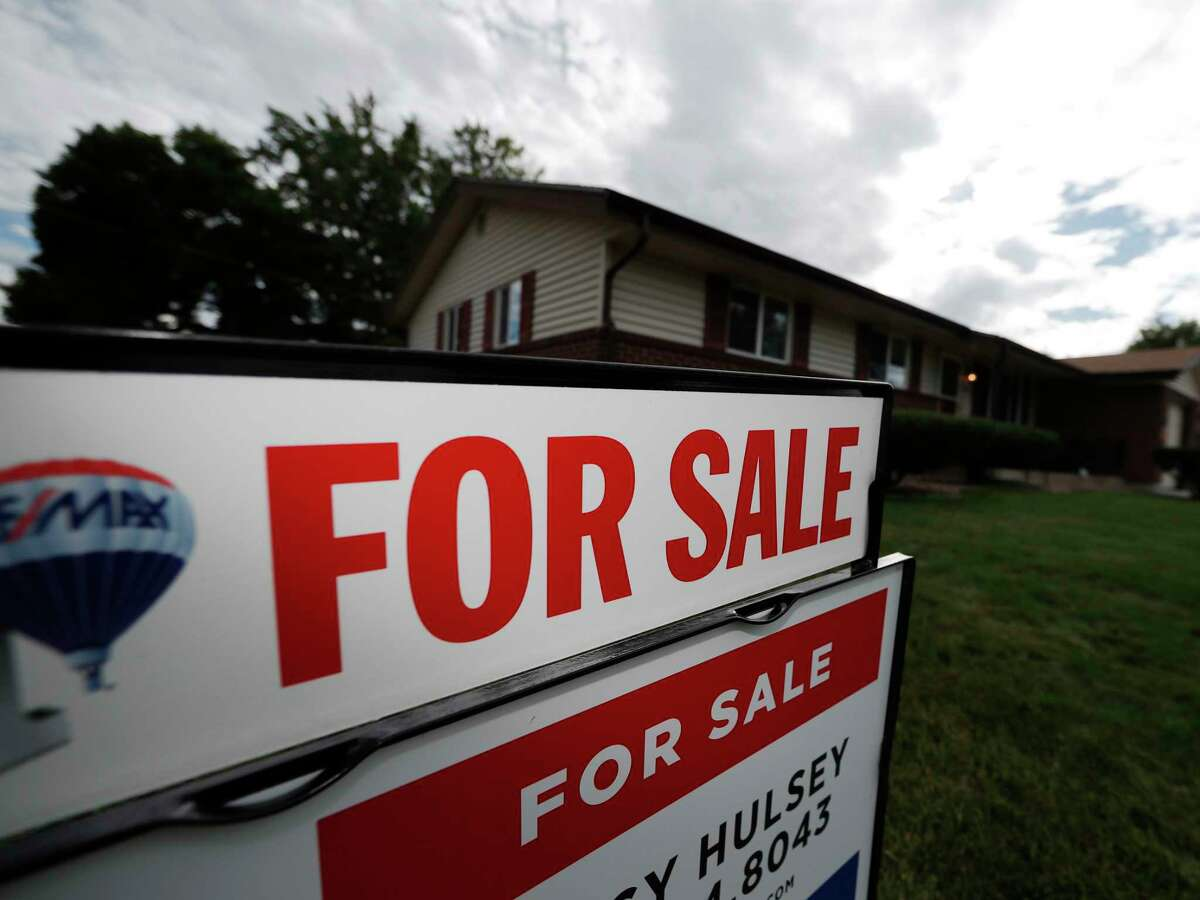 FILE- In this Oct 2, 2018, file photo, a for sale sign stands outside a home on the market.