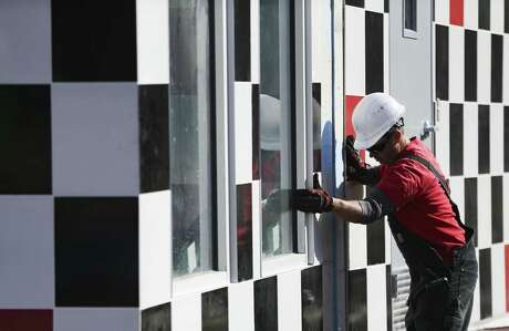 Employees of Nation Wide Steel Works out of Tampa, Florida, assemble a pre-fab Checkers restaurant in Houston on Wednesday, Jan. 24, 2018.