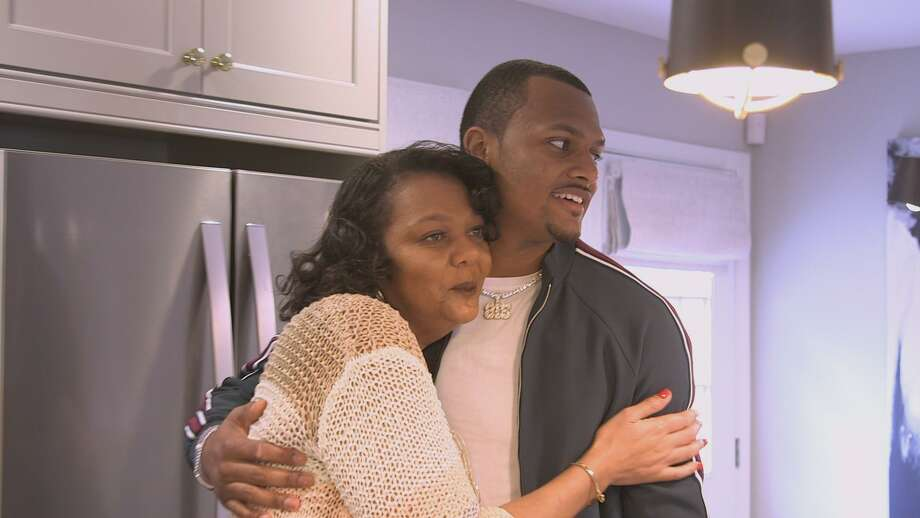 Deshaun Watson, right, embraces his mother, Deann Watson, after a big reveal after a My Houzz makeover transformed her kitchen in her Gainesville, Ga., home. Photo: Houzz
